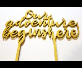 Golden writing on wedding cake