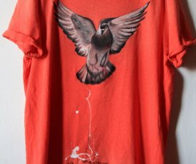 Painted T-shirt shitting pigeon